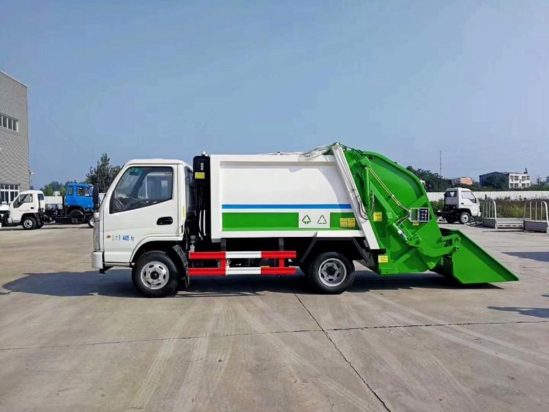 凯马5方压缩式垃圾车正左侧图图