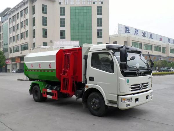 东风大多利卡8方挂桶垃圾车白绿红三色前右面图