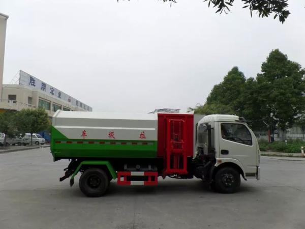 东风大多利卡8方挂桶垃圾车红白绿三色正右侧面图