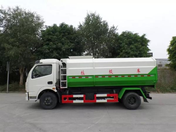 东风大多利卡8方挂桶垃圾车红白绿三色正左侧面图